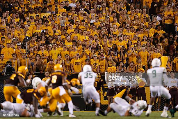 The Arizona State Sun Devils student section watches as fullback Jared Mohamed of the Cal Poly Mustangs carries the football during the college...