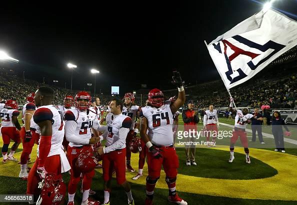 The Arizona Wildcats celebrate their 3124 victory over the Oregon Ducks at Autzen Stadium on October 2 2014 in Eugene Oregon