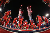 The Arizona Wildcats run out onto the field before the college football game aaUSC Trojans at Arizona Stadium on October 11 2014 in Tucson Arizona