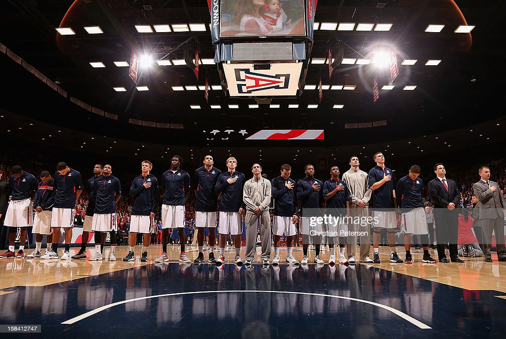 The Arizona Wildcats stand attended for the National Anthem before the college basketball game against the Florida Gators at McKale Center on December 15, 2012 in Tucson, Arizona. The Wildcats defeated the Gators 65-64.