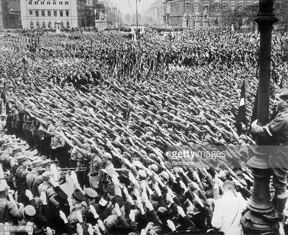 The arms of 300000 men and women are raised in the Fascist salute to Adolf Hitler Chancellor of Germany and leader of the National socialists of that...