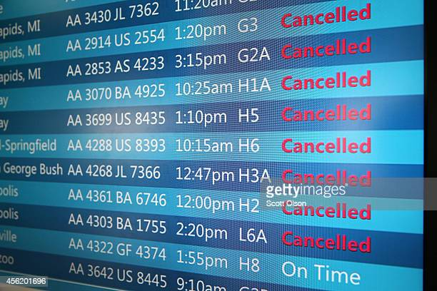 The arrival and departure display at O'Hare International Airport shows a list of cancelled flights on September 27 2014 in Chicago Illinois O'Hare...