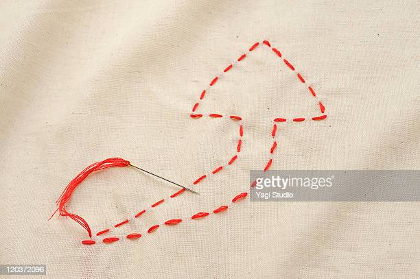 The arrow sewn with a thread