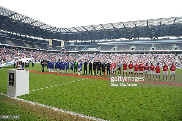 The Arsenal and Everton teams line up before the Womens FA Cup Final at Stadium mk on June 1 2014 in Milton Keynes England