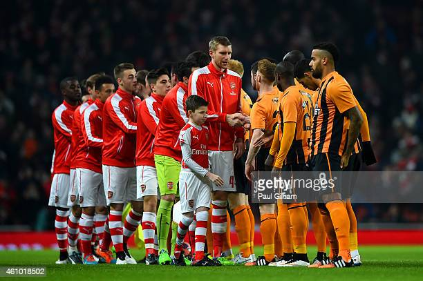 The Arsenal and Hull City players shake hands before the FA Cup Third Round match between Arsenal and Hull City at Emirates Stadium on January 4 2015...
