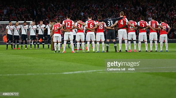 The Arsenal and Tottenham Hotspur teams line up for a minutes silence for remembrance day before the Barclays Premier League match between Arsenal...