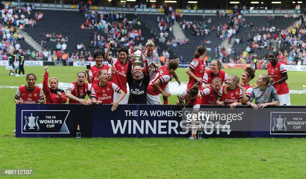 The Arsenal Ladies celebrate winning the FA Cup after the match at Stadium mk on June 1 2014 in Milton Keynes England