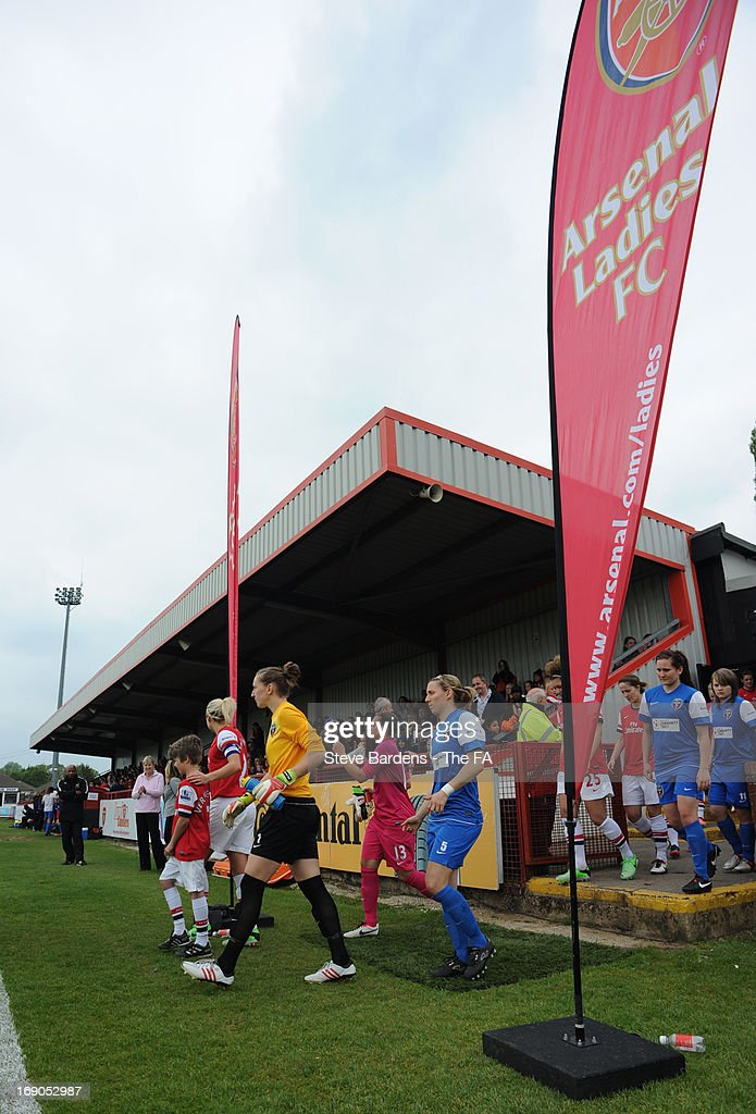 The Arsenal Ladies FC and Bristol Academy Women's FC players walk onto the pitch before the FA WSL Continental Cup match between Arsenal Ladies FC and Bristol Academy at Meadow Park on May 19, 2013 in Borehamwood, England.
