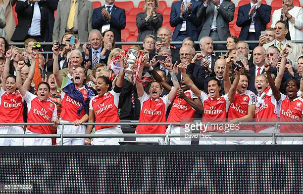 The Arsenal Ladies lift the FA Cup Trophy after the match between Arsenal Ladies and Chelsea Ladies at Wembley Stadium on May 14 2016 in London...