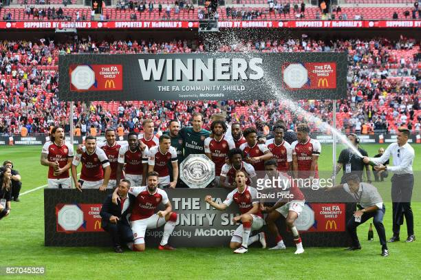 The Arsenal players celebrate winning the Community Shield after the match between Chelsea and Arsenal at Wembley Stadium on August 6 2017 in London...