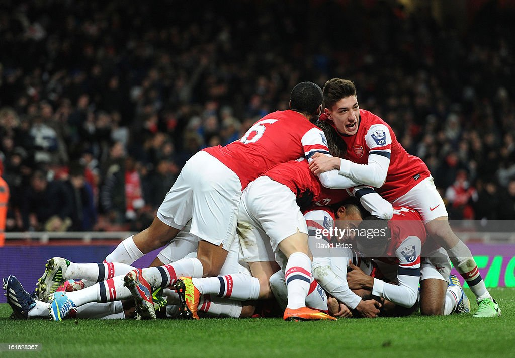 The Arsenal players jump on goalscorer Serge Gnabry to celebrate his goal Arsenal during the NextGen Series Quarter Final match between Arsenal and PFC CSKA at Emirates Stadium on March 25, 2013 in London, England.