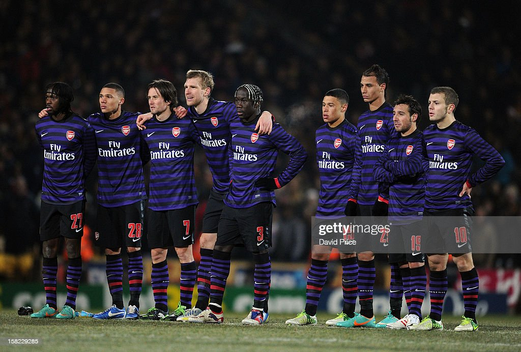 The Arsenal players link up during the penalty shoot out during the Capital One Cup match between Arsenal and Bradford City at Coral Windows Stadium, Valley Parade on December 11, 2012 in Bradford, England.