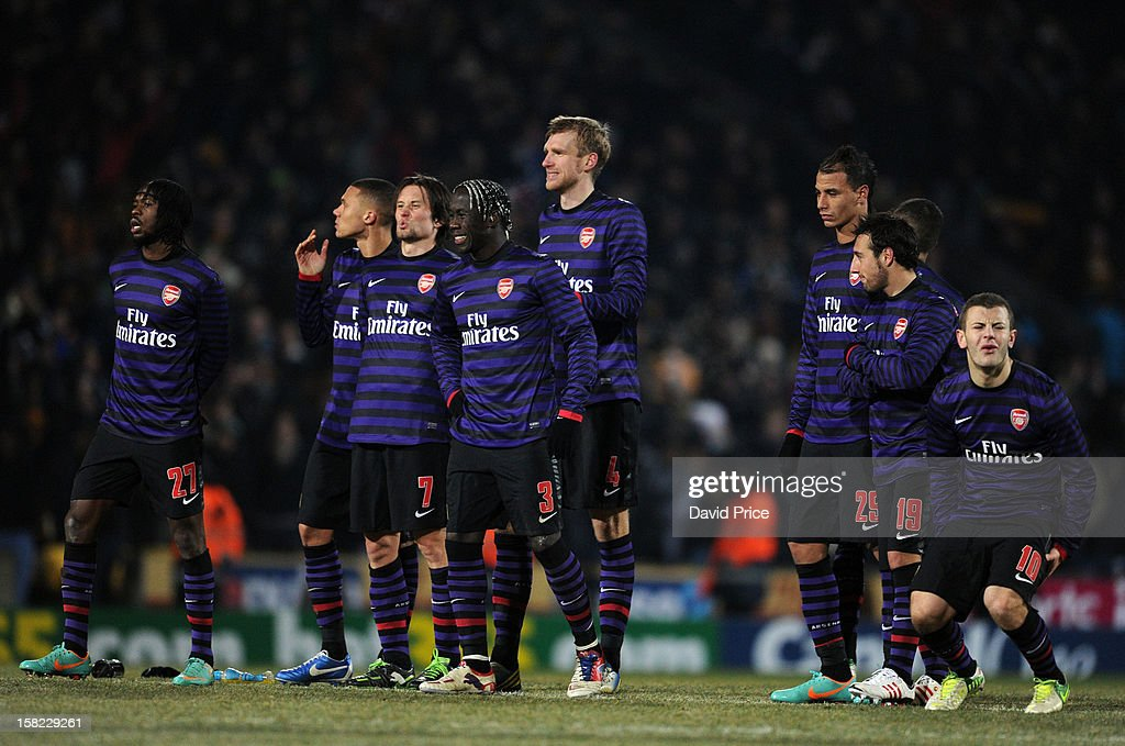 The Arsenal players react to Thomas Vermaelen's penalty miss during the Capital One Cup match between Arsenal and Bradford City at Coral Windows Stadium, Valley Parade on December 11, 2012 in Bradford, England.