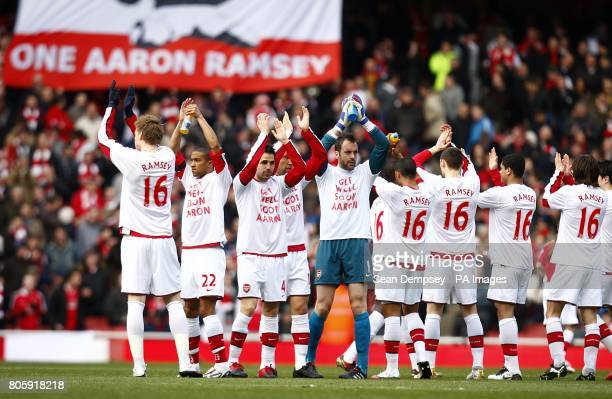 The Arsenal players wear tshirts saying 'Get well soon Aaron' before the game