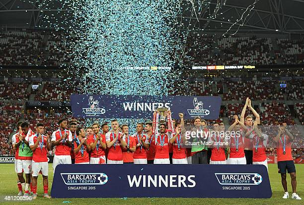 The Arsenal squad celebrate winning the Barclays Asia Trophy after match between Arsenal and Everton at the Singapore National Stadium on July 18...