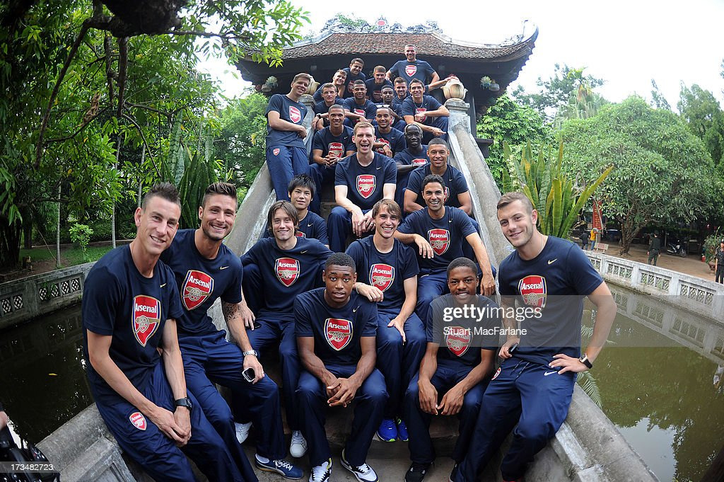 The Arsenal squad visit the One Pillar Pagoda during their sightseeing tour of Hanoi in Vietnam for the club's pre-season Asian tour on July 15, 2013 in Hanoi, Vietnam.