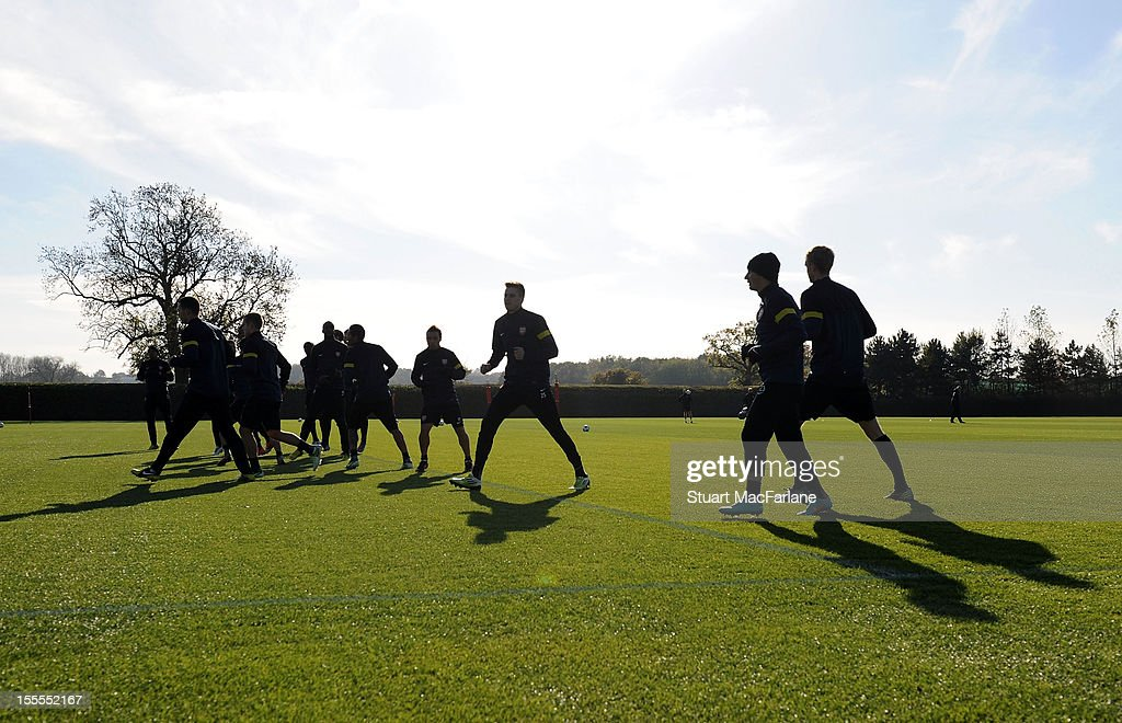 The Arsenal squad warm up before a training session at London Colney on November 5, 2012 in St Albans, England.