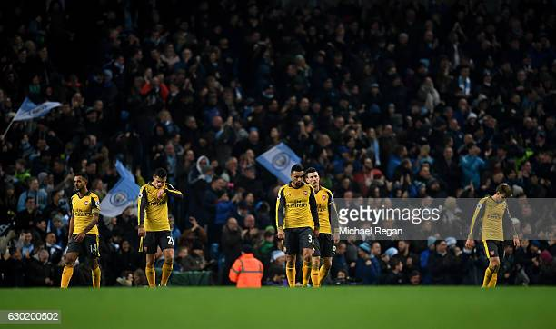 The Arsenal team are dejected after Manchester City score their second goal of the game during the Premier League match between Manchester City and...
