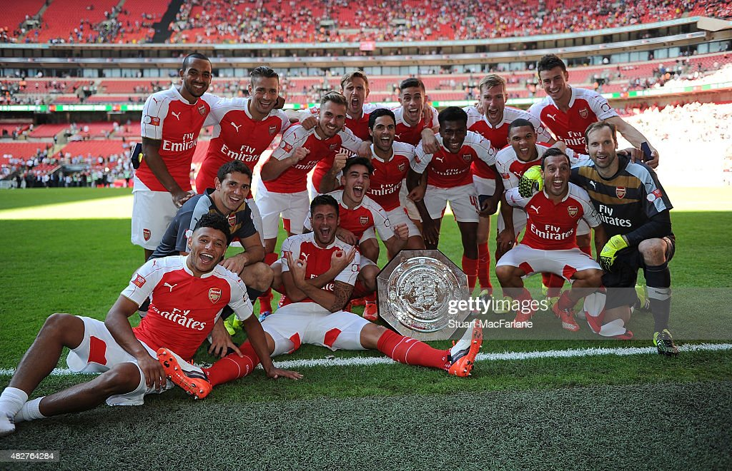 The Arsenal team celebrate after the FA Community Shield match between Chelsea and Arsenal at Wembley Stadium on August 2, 2015 in London, England.