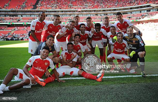 The Arsenal team celebrate after the FA Community Shield match between Chelsea and Arsenal at Wembley Stadium on August 2 2015 in London England