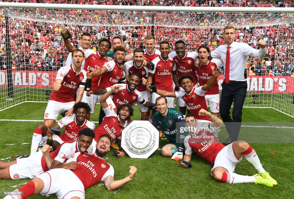 The Arsenal team celebrate after the FA Community Shield match between Chelsea and Arsenal at Wembley Stadium on August 6, 2017 in London, England.