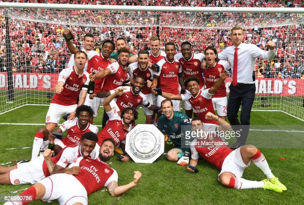 The Arsenal team celebrate after the FA Community Shield match between Chelsea and Arsenal at Wembley Stadium on August 6 2017 in London England
