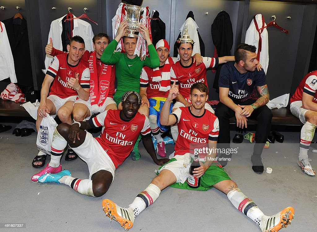 (MINIMUM PRINT/BROADCAST FEE OF GBP 150, ONLINE FEE OF GBP 75 PER IMAGE, OR LOCAL EQUIVALENT) The Arsenal team celebrate in the changing room after winning the FA Cup Final against Hull City at Wembley Stadium on May 17, 2014 in London, England.