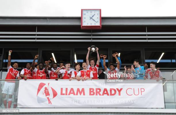 The Arsenal team celebrate winning the Liam Brady Cup after the match between Arsenal and Juventus in the Liam Brady Cup on April 1st 2017 in...