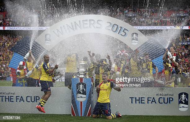 The Arsenal team celebrate with the trophy after winning the FA Cup final football match between Aston Villa and Arsenal at Wembley stadium in London...