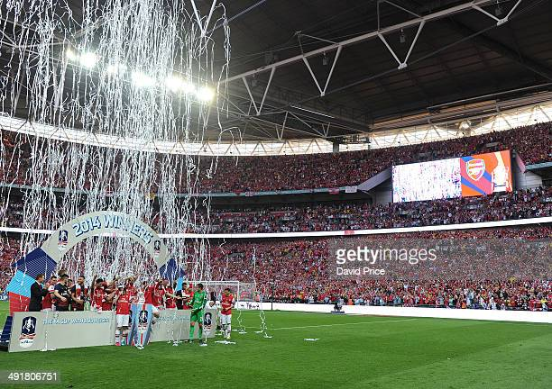 The Arsenal team lifts the FA Cup Trophy after the match between Arsenal and Hull City in the FA Cup Final at Wembley Stadium on May 17 2014 in...