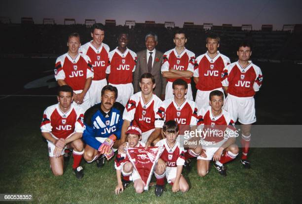 The Arsenal team line up together for a group photograph with Nelson Mandela prior to a friendly match Back Row left to right Lee Dixon Andy Linighan...