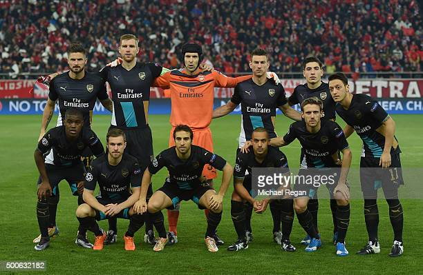 The Arsenal team line up together prior to the start of the UEFA Champions League Group F match between Olympiacos FC and Arsenal FC at Karaiskakis...