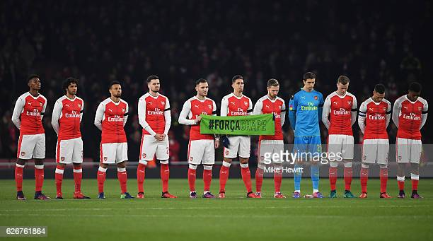The Arsenal team observe a minutes silence ahead of the EFL Cup quarter final match between Arsenal and Southampton at the Emirates Stadium on...