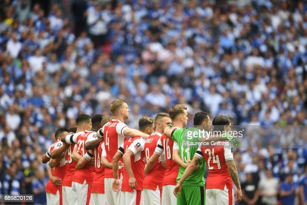 The Arsenal team stand together in support of those who lost their lives in the Manchester Terror attack prior to the Emirates FA Cup Final between...