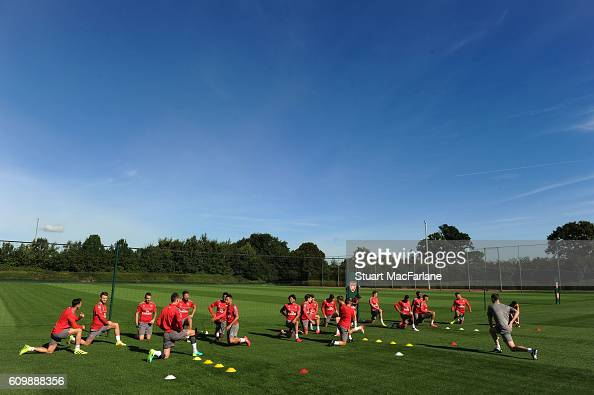 The Arsenal team warm up before a training session at London Colney on September 23 2016 in St Albans England
