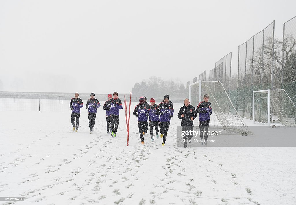 The Arsenal team warm-up before a training session at London Colney on January 18, 2013 in St Albans, England.