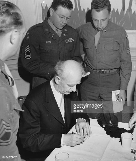 The art director of the Salzburg Festival Wilhelm Furtwaengler is signing autographs for allied soldiers Salzburg About 1948 Photograph