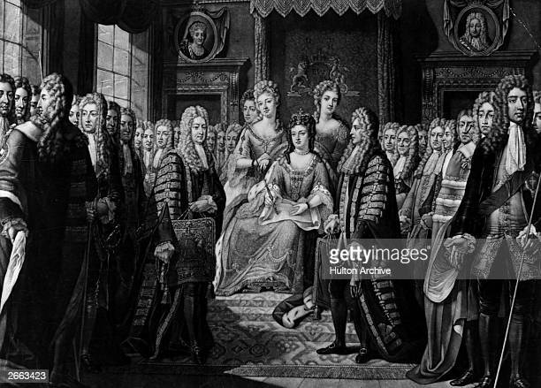 The Articles of the Union of the Parliaments of England and Scotland are presented to Queen Anne at court by the Duke of Queensberry on behalf of...