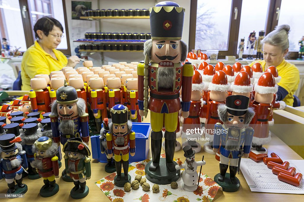 The Artisans Martina Beyer (l.) and Christina Reimer at the Seiffener Volkskunst Christmas decorations manufactory assemble nutcrackers on November 20, 2012 in Seiffen, Germany. Located in the Ore Mountains, Seiffen is home to a plethora of workshops that specialize in hand-painted wooden Christmas decorations in a tradition going back centuries.