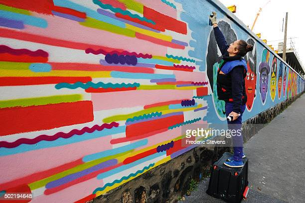 The artist Kashink finishes his work on the Rosa Parks Wall which consists of a huge street art mural 450 meters long made by iconic streetartist...