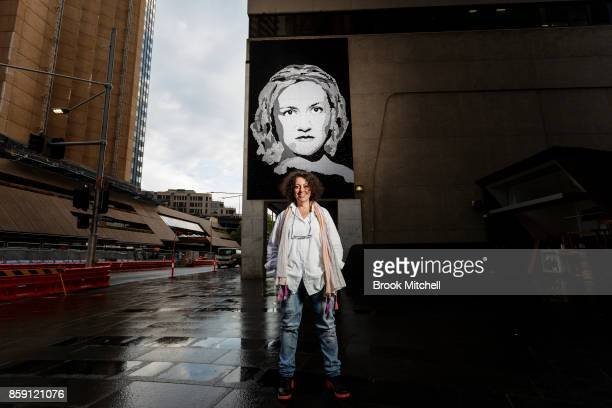 The artist Noula in front of a mural she constructed of domestic abuse advoctae Felicity Cook in George Street during the launch of the 'Love...
