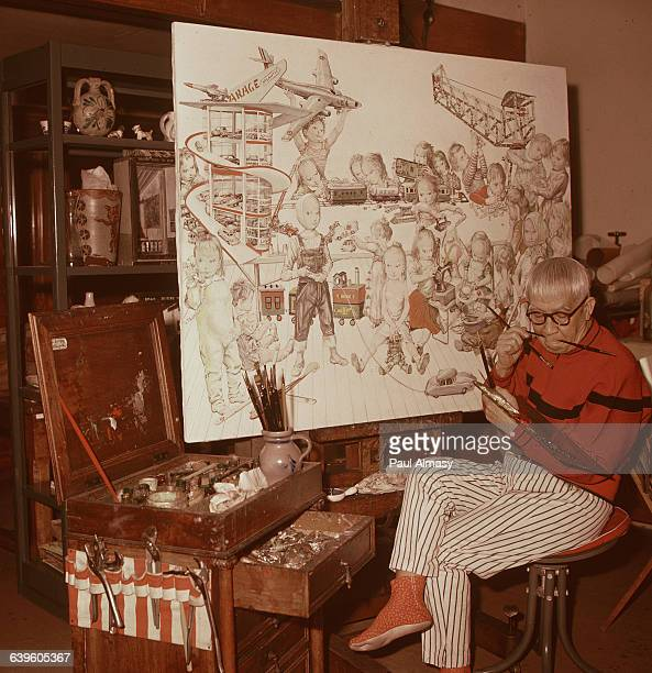 The artist Tsougharu Foujita at work on a painting of children playing | Location Foujita's studio in France