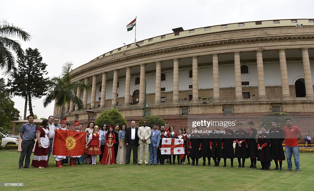 The artists from various countries pose outside Parliament on May 3, 2016 in New Delhi, India. They are here to take part in the 14th international festival of language and culture to be held on 7th of May outside Parliament.
