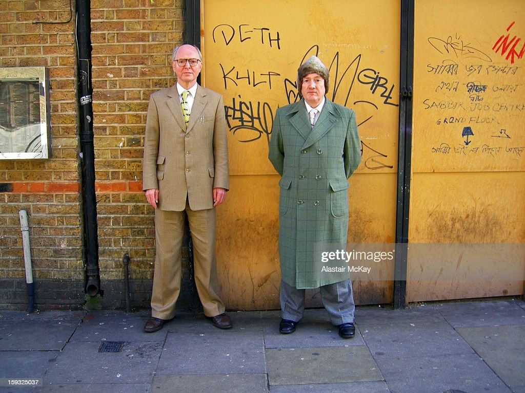 CONTENT] The artists, Gilbert and George, in Brick Lane, East London.