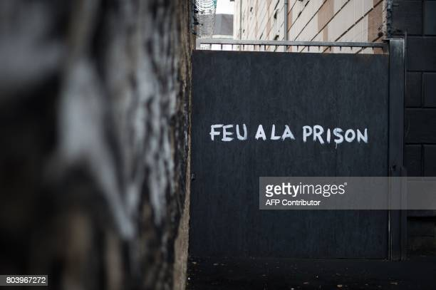 The artwork 'Entrez libre' by Pick Up Production is displayed on the door of the former prison of Nantes on June 29 2017 during the 6th edition of...
