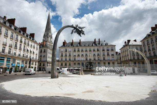 The artwork 'La terre ou les arbres revent' by French artist Laurent Pernot is pictured in Nantes western France on June 29 2017 during the 6th...