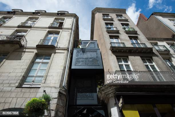 The artwork 'Micr'Home' by French artist Myrtille Drouet is pictured in Nantes western France on June 29 2017 during the 6th edition of the 'A...