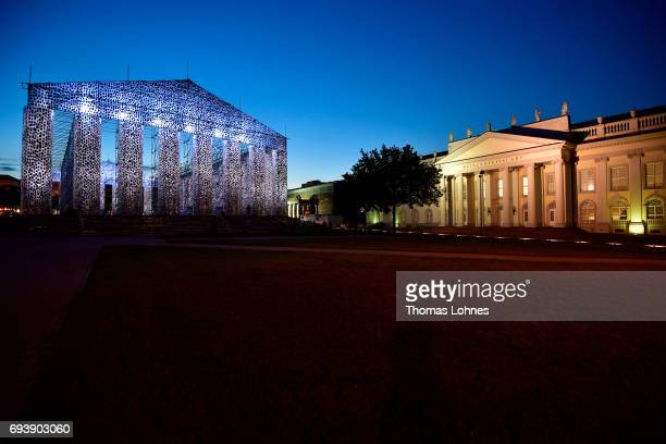 The artwork 'The Parthenon of Books' with donated books by the artist Marta Minujin and the 'Fridericanum' is illuminated at night on June 8 2017 in...