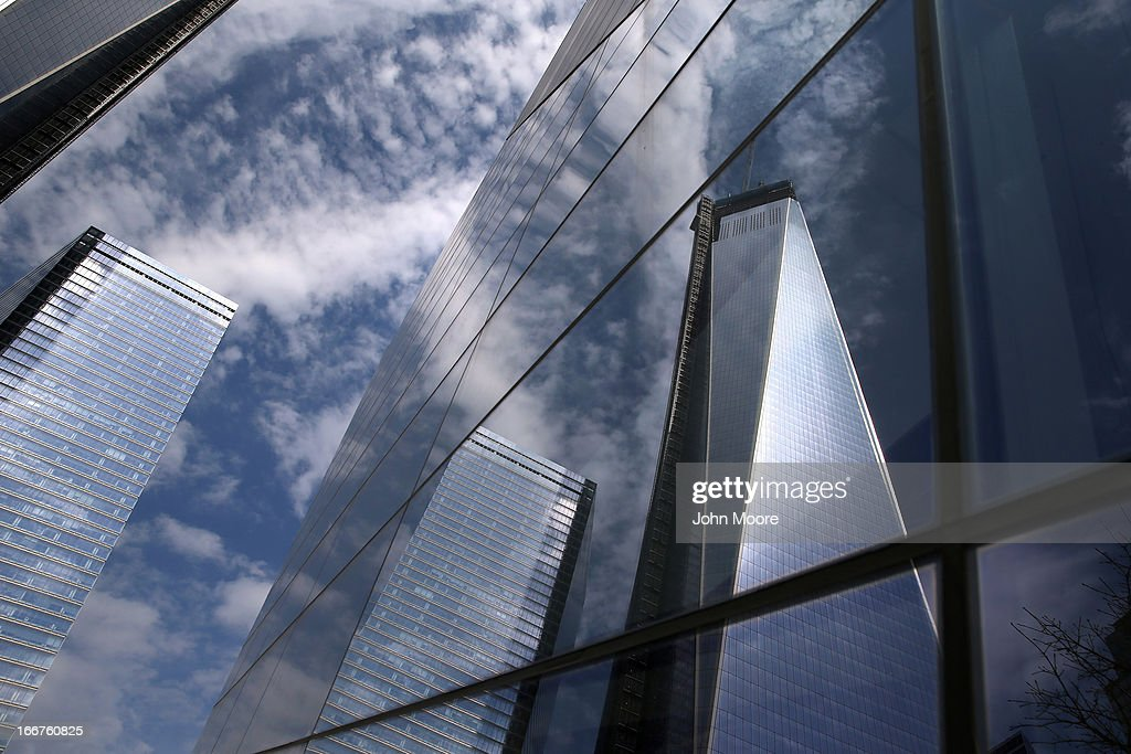 The as yet unfinished One World Trade tower (R) rises over the September 11 Memorial and Museum on April 16, 2013 in New York City. Security was high throughout New York City a day after the Boston Marathon attacks.