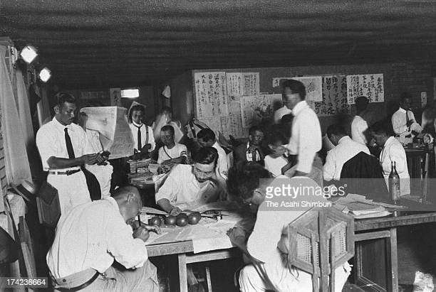 The Asahi Shimbun journalists work at a temporary office set at the Imperial Hotel after the Great Kanto Earthquake in September 1923 in Tokyo Japan...